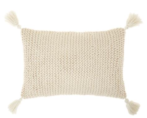 Cuscino in maglia con nappe/ponpon